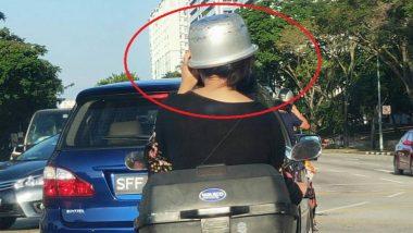 अगं बाई! हेल्मेट सापडत नाही, महिलेने डोक्याला घातला कुकर; छायाचित्र व्हायरल