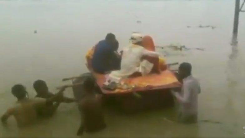 मुसळधार पावसामुळे बिहारमध्ये पूर; चक्क प्लास्टिक ड्रमच्या बोटीतून नवरा नवरीची पाठवणी (Video)