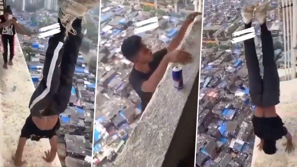 Video: कांदिवली च्या एका टोलेजंग इमारतीच्या सज्जावर खाली डोकं वर पाय करुन तरुणाची जीवघेणी स्टंटबाजी, तिघांविरुद्ध गुन्हा दाखल