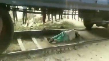 दैव बलवत्तर म्हणून बचावली महिला, रोहतक मध्ये चालत्या ट्रेनखाली झोपून केला स्वतःचा बचाव; पहा काळजाचा थरकाप उडवणारा हा व्हिडिओ (Watch Video)