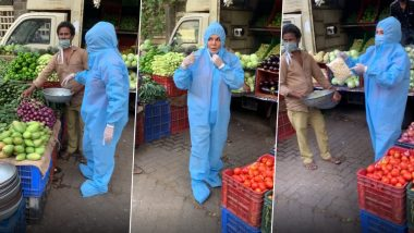 कोविड-19 च्या भीतीपोटी Rakhi Sawant ने PPE किट घालून केली भाजी खरेदी; पहा मजेशीर Videos